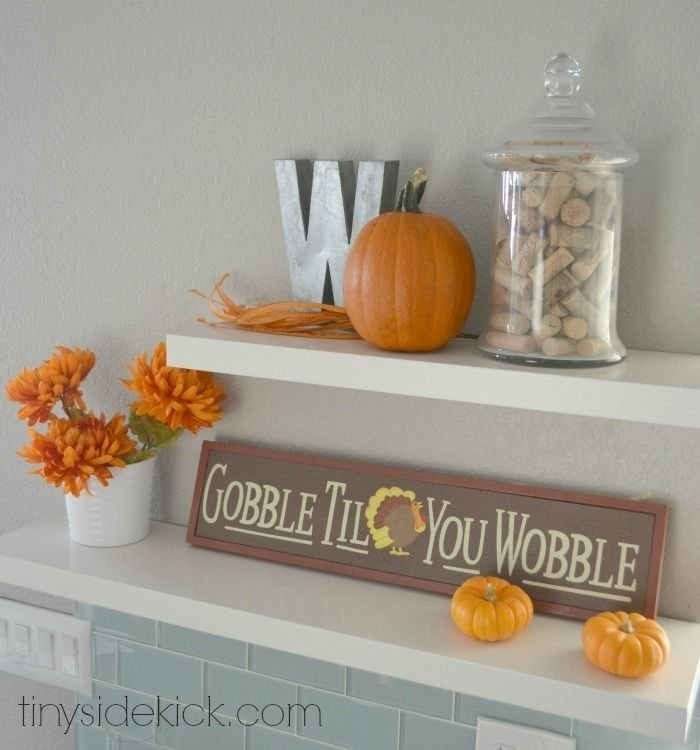 open kitchen shelves decorated for fall