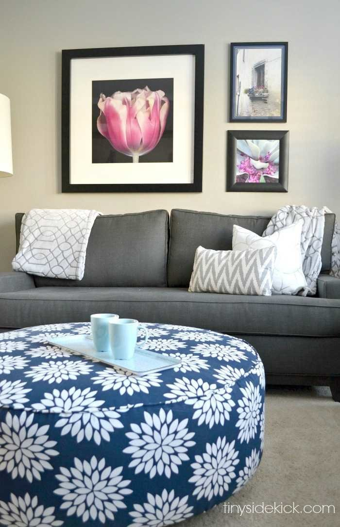 Grey, white, and blue, living room with pops of pink