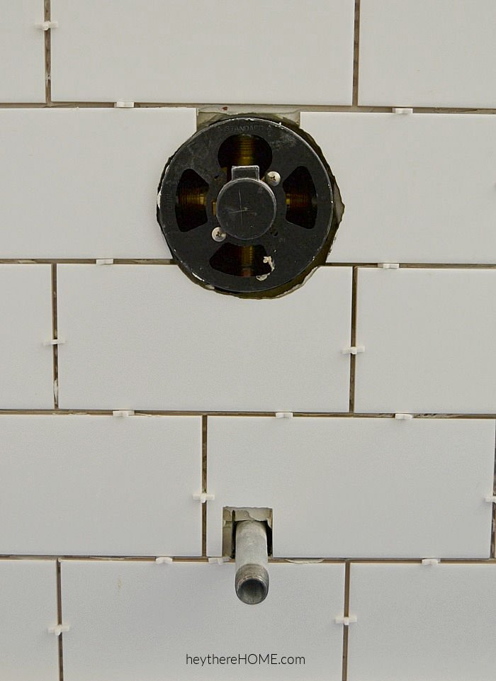how to tile around faucets