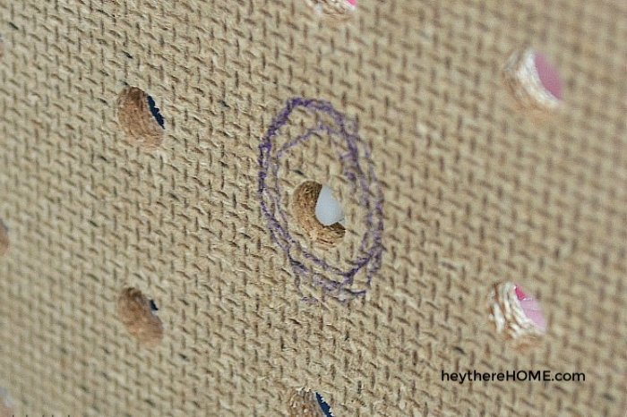 marking the holes for a DIY tufted headboard