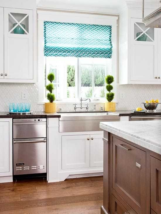 white kitchen with aqua accents