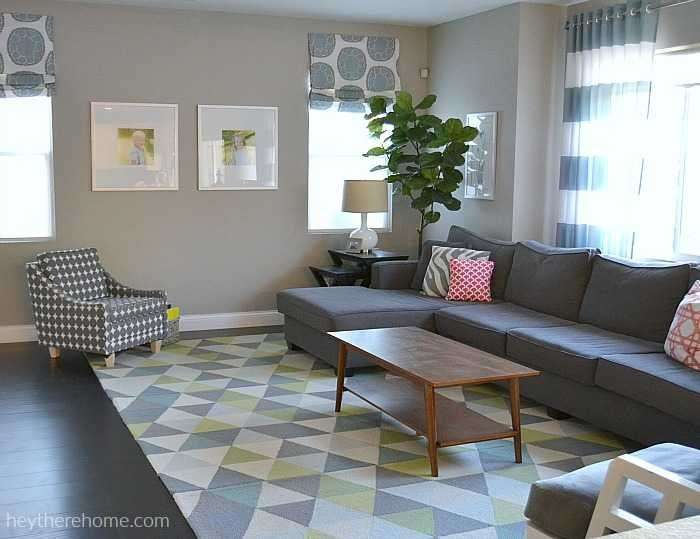 living room with greys and pops of color a simple home decor style - Home Decor Styles