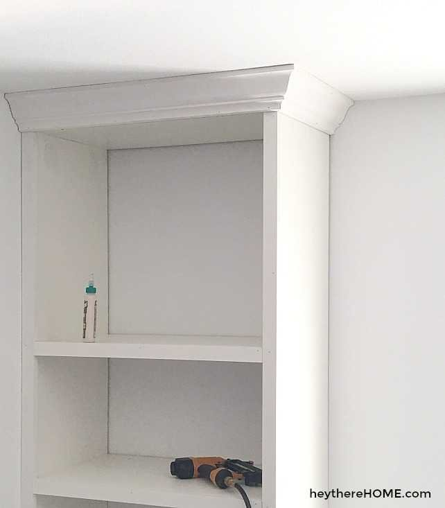built in shelves with crown molding