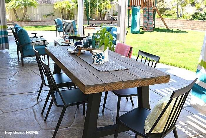 outdoor dining room with teak table