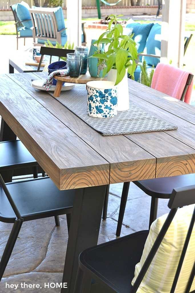 teak outdoor table with metal legs