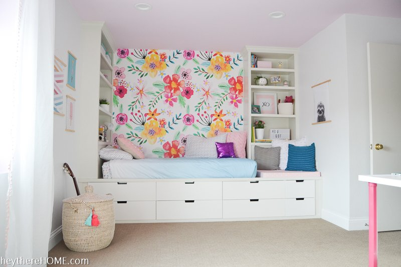 built in bed with removable wallpaper in girls room