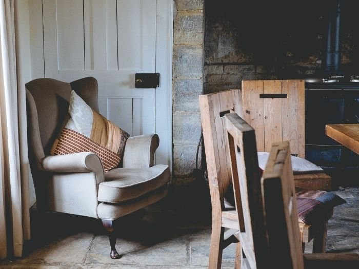 rustic style features raw materials on walls and chairs